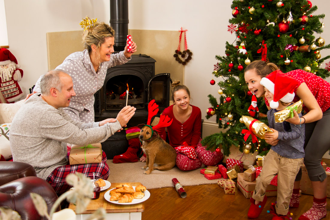 picture of happy family celebrating on modest budget for Christmas