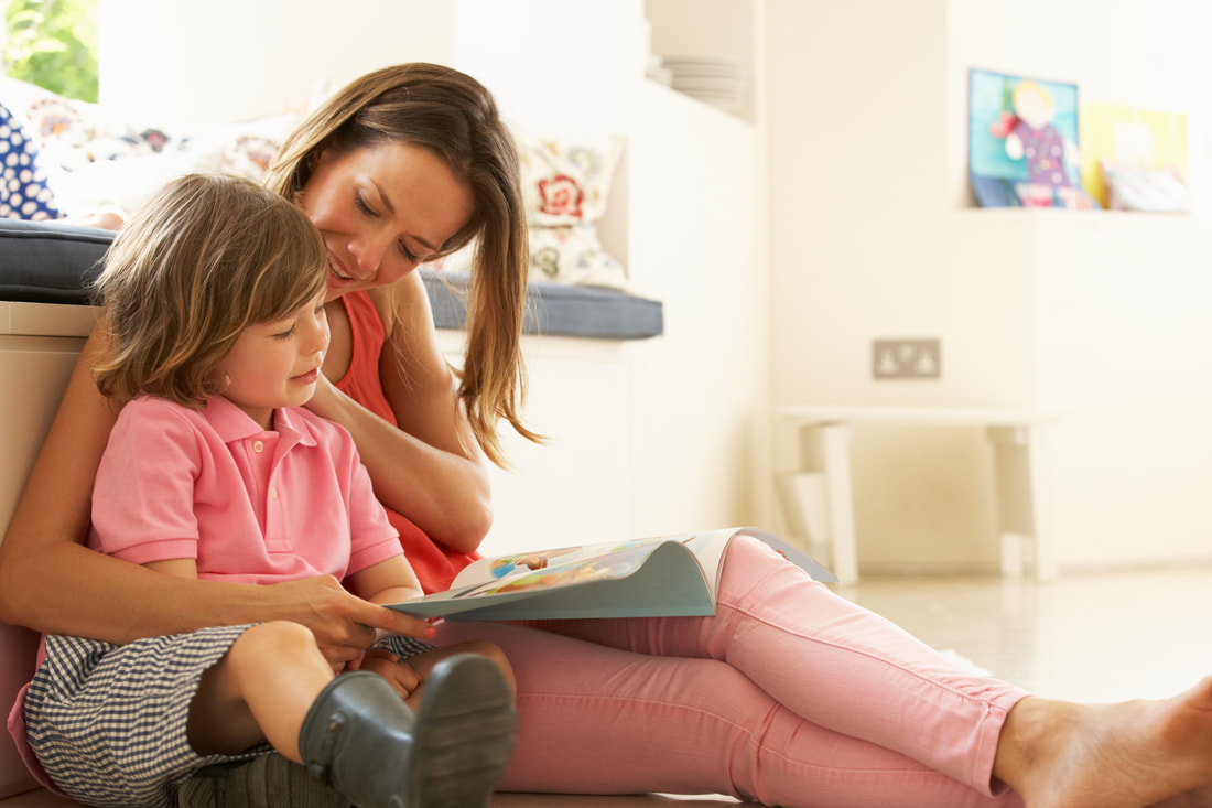 Picture of mom making an effort to read with her child