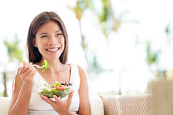 Picture of woman eating healthy for new year